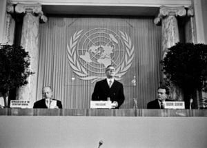 26 March 1968 - Opening of the Conference on the Law of Treaties, Hofburg Palace, Vienna, Austria: Professor Roberto Ago (Italy), addressing the delegates following his unanimous election as President of the Conference (centre); Mr. C.A. Stavropoulos, Representative of the Secretary-General (left); and Mr. A.P. Movchan, Executive Secretary (right).